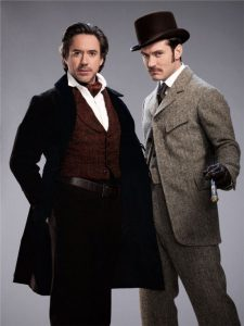 Sherlock Holmes and John Watson portrayed by Robert Downey Jr. and Jude Law.