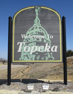 "A sign saying ""Welcome to Topeka"""