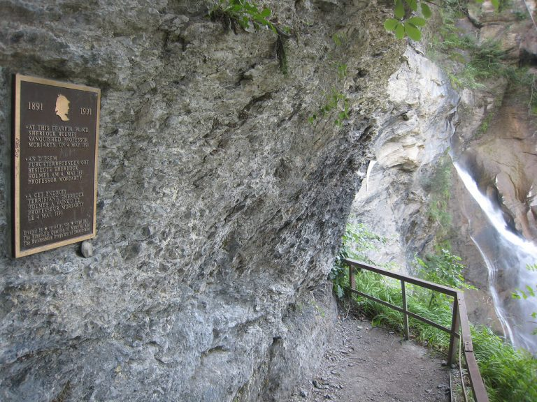 """Reichenbach Falls, with a plaque reading """"At this fearful spot Sherlock Holmes vanquished Professor Moriarty, on 4 May 1891"""